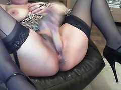 Stocking clad Jess dildo fucks her..