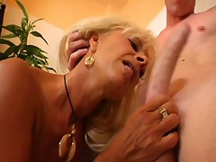 Blond MILF Commons Young Guy's Ass in..